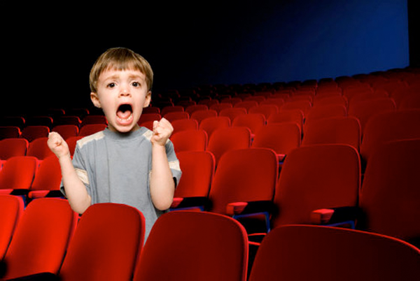 kid screaming in an empty theater