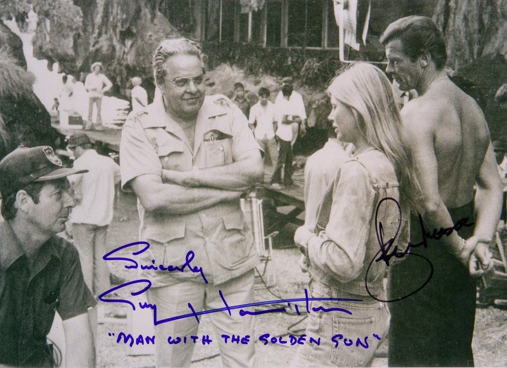 Guy Hamilton on the set of Man with the Golden Gun, alongside Cubby Broccoli, Britt Ekland and Roger Moore.
